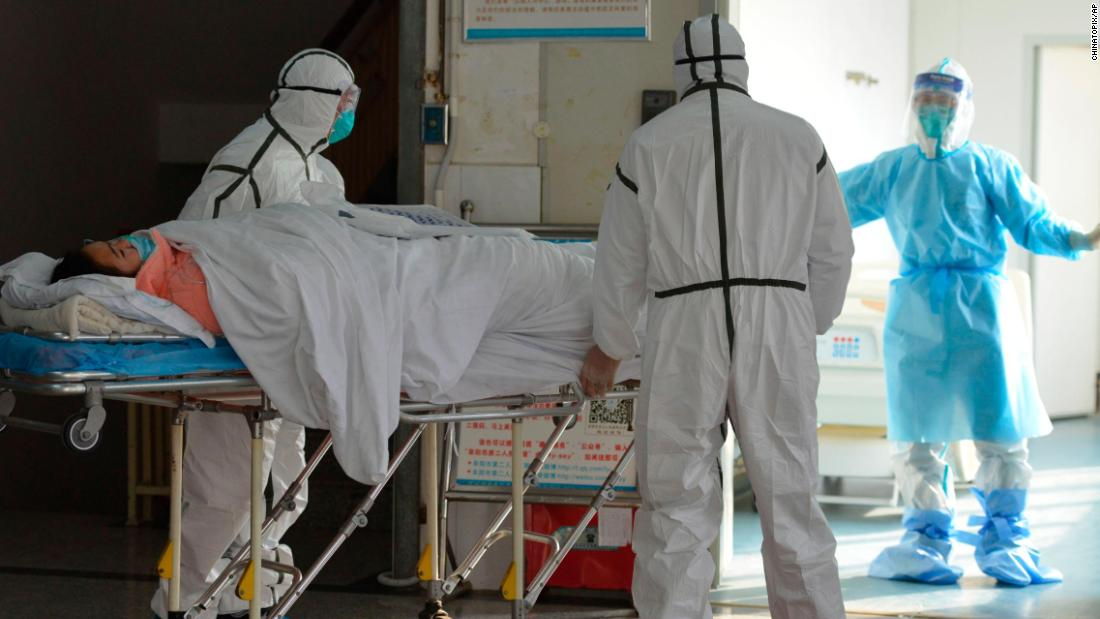 Medical workers move a coronavirus patient into an isolation ward at the Second People's Hospital in Fuyang, China, on February 1.