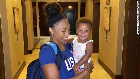 Six-time Olympic gold medalist Allyson Felix holds her daughter, Camryn.