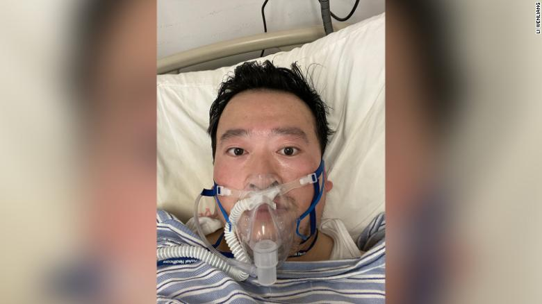 Wuhan doctor Li Wenliang in an intensive care bed on oxygen support after contracting the coronavirus.
