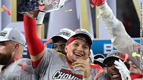 Patrick Mahomes of the Kansas City Chiefs raises the Vince Lombardi Trophy after defeating the San Francisco 49ers in Super Bowl LIV.