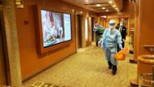 Health authorities were screening guests on the Diamond Princess Tuesday.