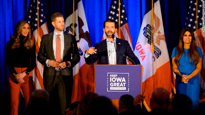 """Lara Trump (L), her husband Eric Trump (2L) and Kimberly Guilfoyle (R) listen to Donald Trump Jr. speak during a """"Keep Iowa Great"""" press conference in Des Moines, Iowa, on February 3, 2020."""