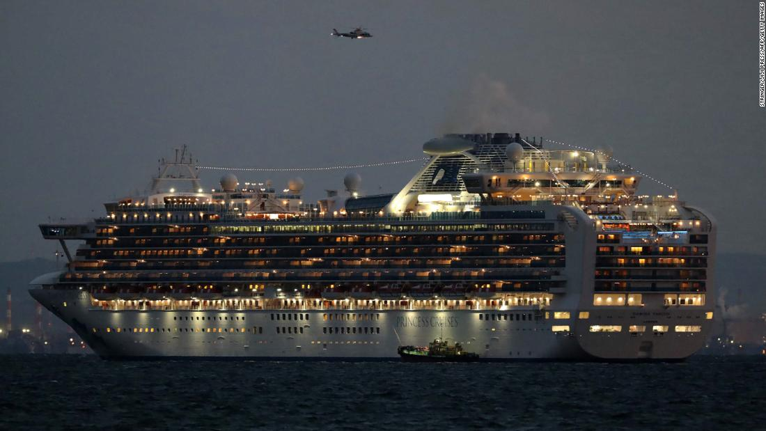 The Diamond Princess cruise ship sits anchored in quarantine off the port of Yokohama on February 4. It arrived a day earlier with passengers feeling ill.