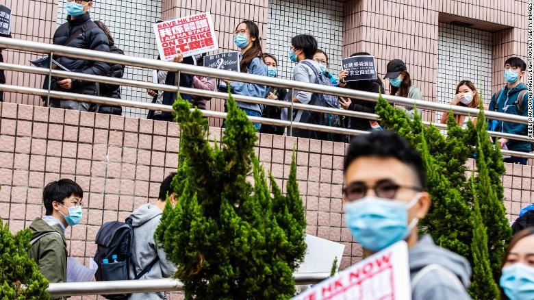 Striking hospital workers in Hong Kong demand the closure of the border with mainland China on Thursday, February 4.