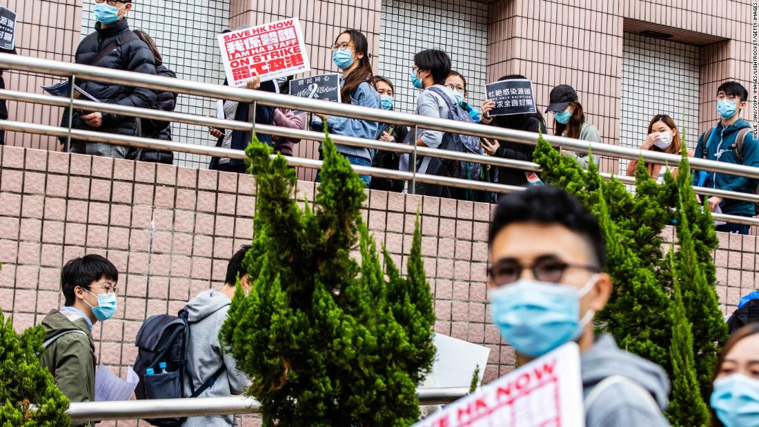 Striking hospital workers in Hong Kong demand the closure of the border with mainland China on February 4.