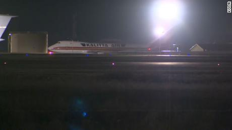 One of the charter flights taxis at Travis Air Force Base after landing on Wednesday morning.