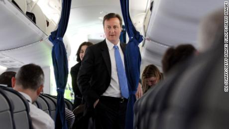 David Cameron's bodyguard left a loaded gun in the toilet on a commercial flight, reports say