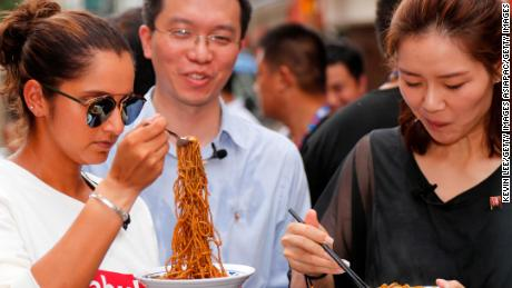 Sania Mirza of India and Li Na of China taste Wuhan noodles on September 25, 2017.