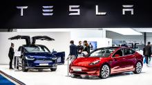Brussels, Belgium, Jan 18, 2019: metallic red Tesla Model 3 and blue Tesla model X at Brussels Motor Show.