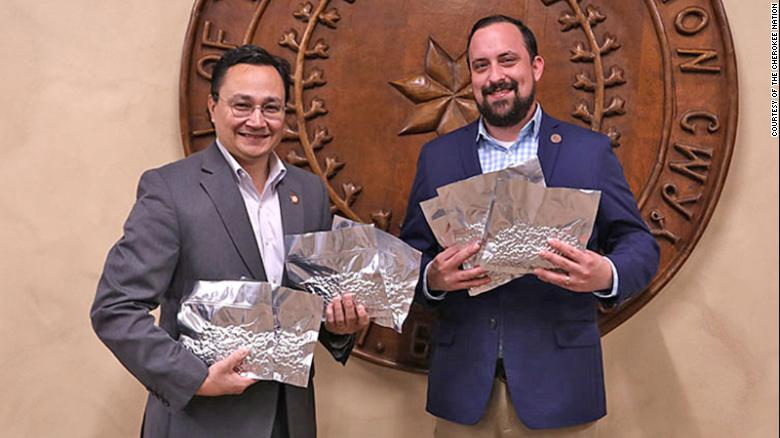 Cherokee Nation Principal Chief Chuck Hoskin Jr. and Secretary of Natural Resources Chad Harsha with heirloom seeds being sent to the Svalbard Global Seed Vault.