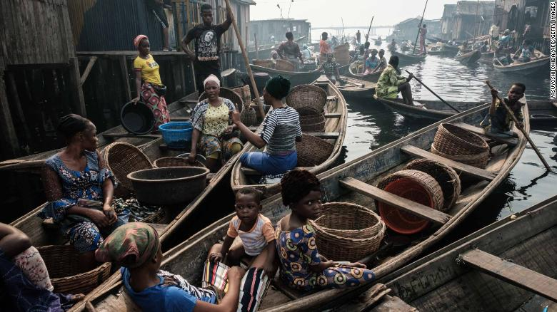 Fishermen and women on a waterway in the Makoko on March 2, 2019.