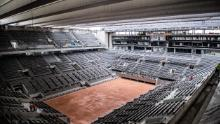 TOPSHOT - This picture taken on February 5, 2020 at the Roland Garros stadium in Paris shows the construction work of the newly built roof of the Philippe Chatrier central tennis court. (Photo by Martin BUREAU / AFP) (Photo by MARTIN BUREAU/AFP via Getty Images)