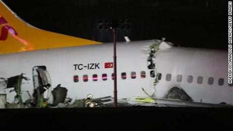 The plane broke apart after skidding off the runway.