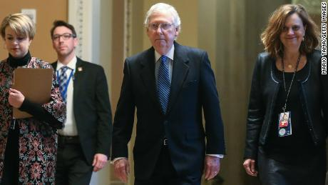 Sen. Mitch McConnell (R-KY), C, walks to the Senate chamber at the U.S. Capitol as the Senate impeachment trial of U.S. President Donald Trump continues on February 5, 2020 in Washington, DC.