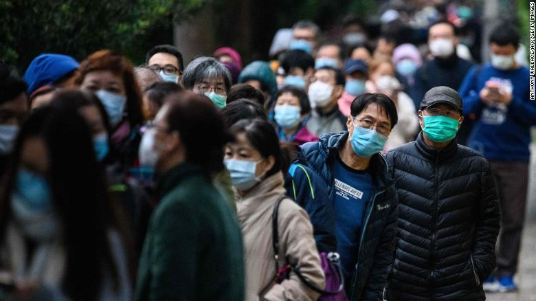 Planeloads of Americans flee growing coronavirus outbreak in Wuhan as 12th case is reported in the US