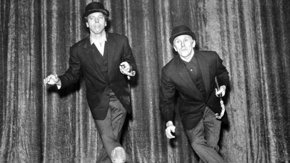 "Douglas, right, rehearses with Burt Lancaster in preparation for the ""Night of 100 Stars"" event in London in 1958. The two stars appeared in five films together, from ""Gunfight at the O.K. Corral"" (1957) to ""Tough Guys"" (1986)."