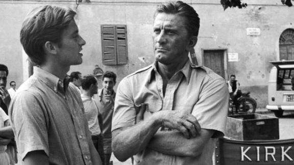 "Douglas appears with his son Michael on the set of the film ""Cast a Giant Shadow"" in Rome in the mid-'60s. Michael Douglas had a small uncredited role in his dad's movie. He would go on to become a major film star himself in the 1980s and '90s."