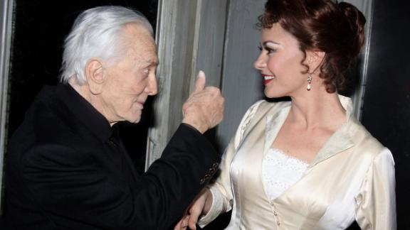 "Douglas greets his daughter-in-law Catherine Zeta-Jones backstage at Broadway's ""A Little Night Music"" in 2009. She was starring in a revival of the Stephen Sondheim-Hugh Wheeler musical."