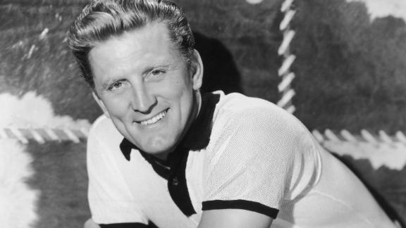 Kirk Douglas poses for a studio portrait circa 1950.