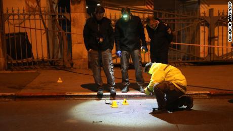 Israeli police officers inspect the scene of Thursday's ramming attack in Jerusalem.