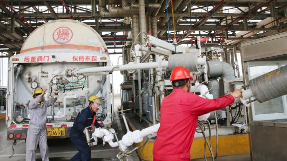 Workers serve a tanker truck at the PetroChina's LNG reception terminal in Rudong in east China's Jiangsu province Wednesday, June 26, 2019. China, the worlds second-largest importer of LNG, imported 53.7 million tonnes of LNG in 2018, a rise of almost 38 percent compared to 2017. (Photo credit should read XU CONGJUN / Barcroft Media via Getty Images)