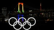 A general view of the Olympic rings as they are illuminated for the first time to mark 6 months to go to the Olympic games at Odaiba Marine Park on January 24, 2020.