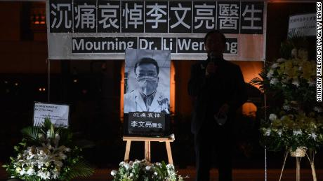 People attend a vigil in Hong Kong on February 7, 2020 for  whistleblowing doctor Li Wenliang, 34, who died in Wuhan after contracting the virus while treating a patient.