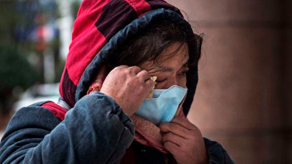 A woman grieves while paying tribute to Li at Li's hospital in Wuhan on February 7.