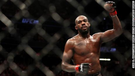 Jones celebrates after his UFC Light Heavyweight Title victory over  Thiago Santos.