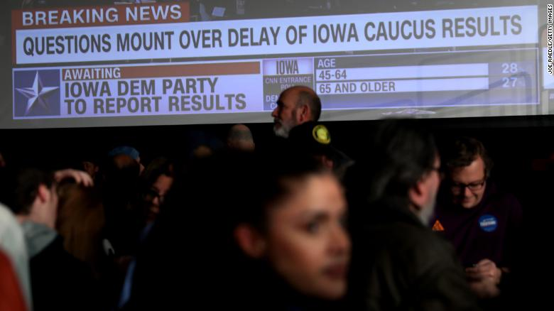 Voters watch CNN coverage on election night.