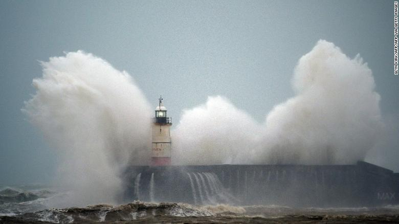 Waves crash over a lighthouse on the south coast of England on February 9, 2020, as Storm Ciara hits the UK.