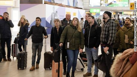 Travelers wait in the departure hall of Schiphol airport on February 9, 2020. Many flights there have been canceled due to Storm Ciara.