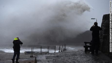 Storm Ciara causes large waves in Lyme Regis, in southwestern England, on Sunday.