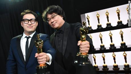 In this handout photo provided by A.M.P.A.S. Best Original Screenplay award winners Han Jin Won and Bong Joon Ho pose backstage during the 92nd Annual Academy Awards at the Dolby Theatre on February 09, 2020 in Hollywood, California.