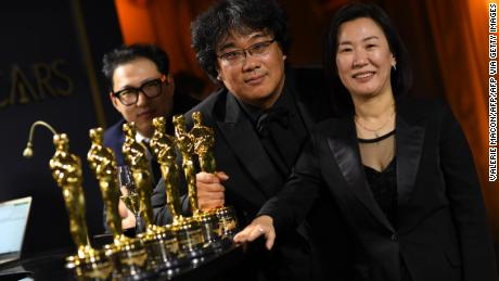 """Parasite"" writer Han Jin Won, director Bong Joon Ho and producer Kwak Sin Ae pose at the 92nd Oscars Governors Ball. (Photo by VALERIE MACON / AFP)"
