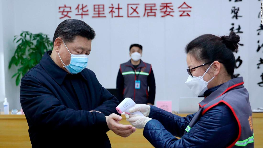 Chinese President Xi Jinping has his temperature checked during an appearance in Beijing on February 10.