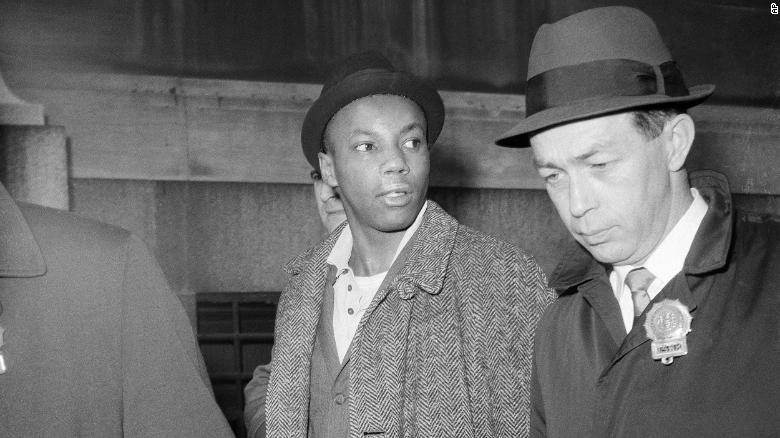 Norman 3X Butler is escorted by police after his arrest in New York on February 26, 1965.