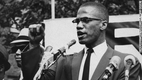 circa 1963:  American civil rights leader Malcolm X (1925 - 1965)  at an outdoor rally, probably in New York City.  (Photo by Bob Parent/Hulton Archive/Getty Images)