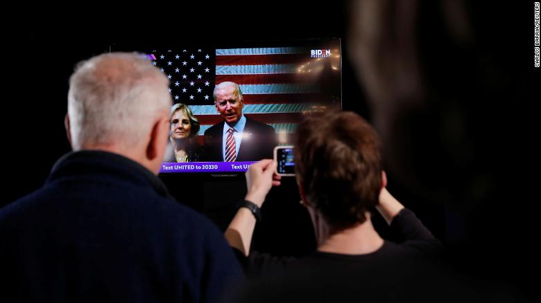 Biden accompanied by his wife Jill speaks to supporters on televised message from South Carolina at his New Hampshire primary night rally in Nashua, New Hampshire