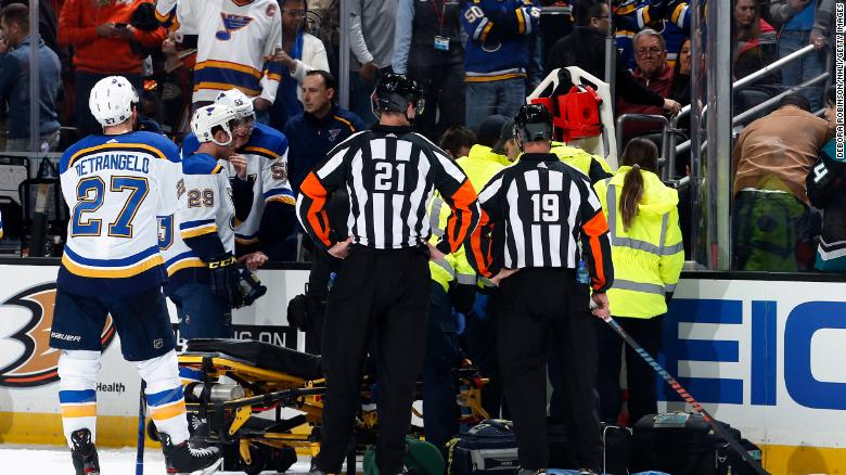 The St. Louis Blues watch as the paramedics tend to Jay Bouwmeester #19 of the St. Louis Blues after he collapsed on the bench during the first period of the game against the Anaheim Ducks at Honda Center on February 11, 2020 in Anaheim, California.