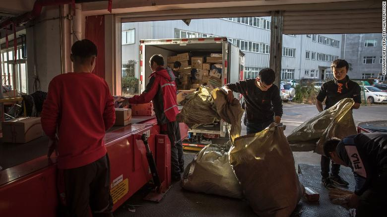Workers sorting packages at a delivery station for JD.com in Beijing in November.