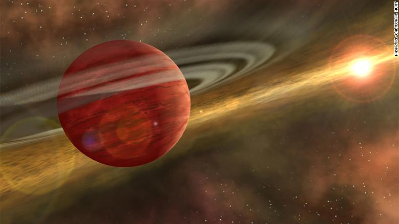 This is an artist's illustration a massive planet orbiting a cool, young star. In the case of the newly discovered system, the planet is 10 times more massive than Jupiter, and the orbit of the planet is nearly 600 times that of Earth around the sun.