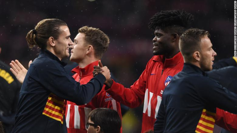 Antoine Griezmann of FC Barcelona shakes hands with former teammate Partey prior to the La Liga match against Atletico at Wanda Metropolitano on December 01, 2019.