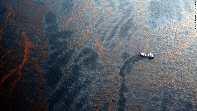 A boat works to collect oil that leaked from the Deepwater Horizon wellhead in the Gulf of Mexico near New Orleans on April 28, 2010, eight days after the explosion.