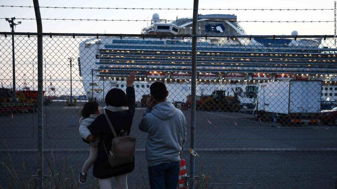 "Relatives of quarantined passengers wave at the Diamond Princess cruise ship as it leaves a port in Yokohama, Japan, to dump wastewater and generate potable water. Dozens of people on the ship <a href=""https://www.cnn.com/2020/02/10/us/coronavirus-cruise-ship-americans-quarantine/index.html"" target=""_blank"">were infected with coronavirus.</a>"