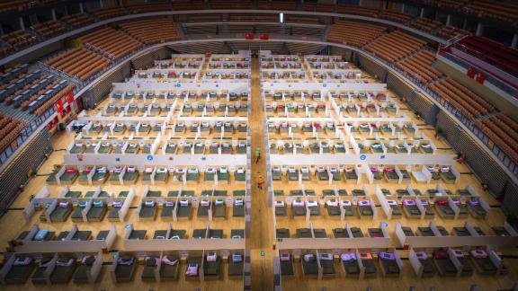 Beds are made in the Wuhan Sports Center, which has been converted into a temporary hospital.