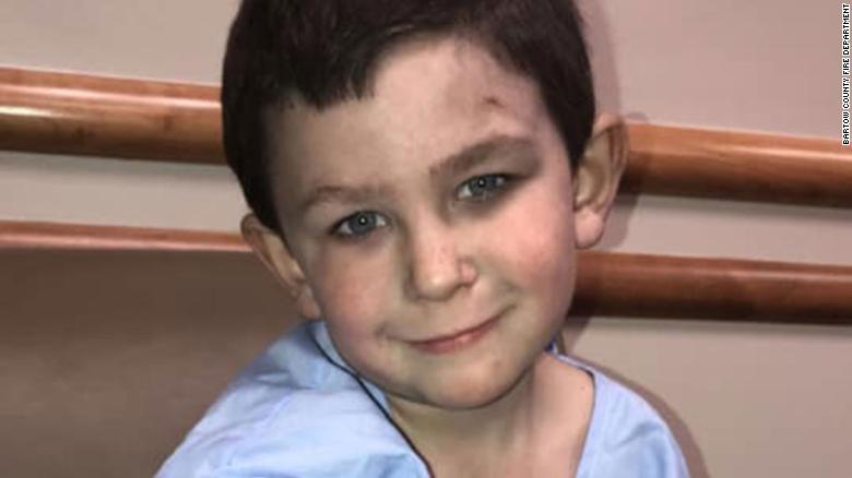 Noah Woods, 5, saved his family of eight from a house fire in Bartow County, Georgia.