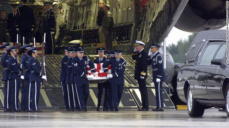 The remains of a sailor killed in the USS Cole attack are carried from a US Air Force transport plane on October 13, 2000 at Ramstein Air Force Base in Germany.