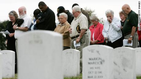 Family members of victims of the USS Cole attack attend a ceremony at the Arlington National Cemetery, Virginia, to mark the fifth anniversary of the attack.