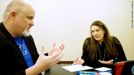 Fred Trotter discusses cybersecurity with Downing during a conference in February 2020.